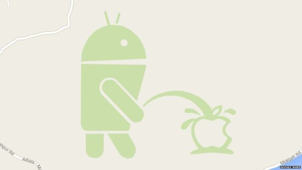 Android mascot urinating on an Apple logo